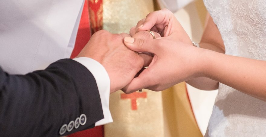 Putting Ring on Groom